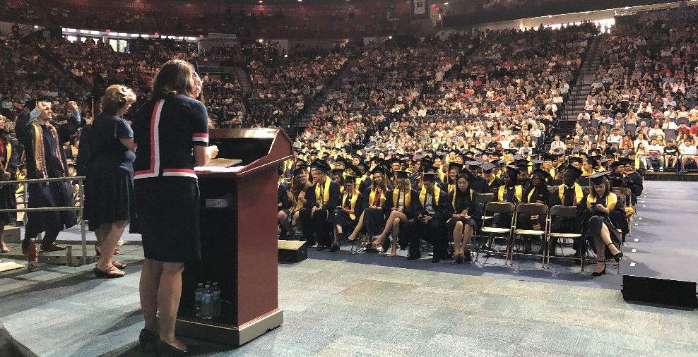 Photo Martha PL Whitaker at Podium Congratulating HAS Graduates at the May 2019 College of Science Graduation Ceremony